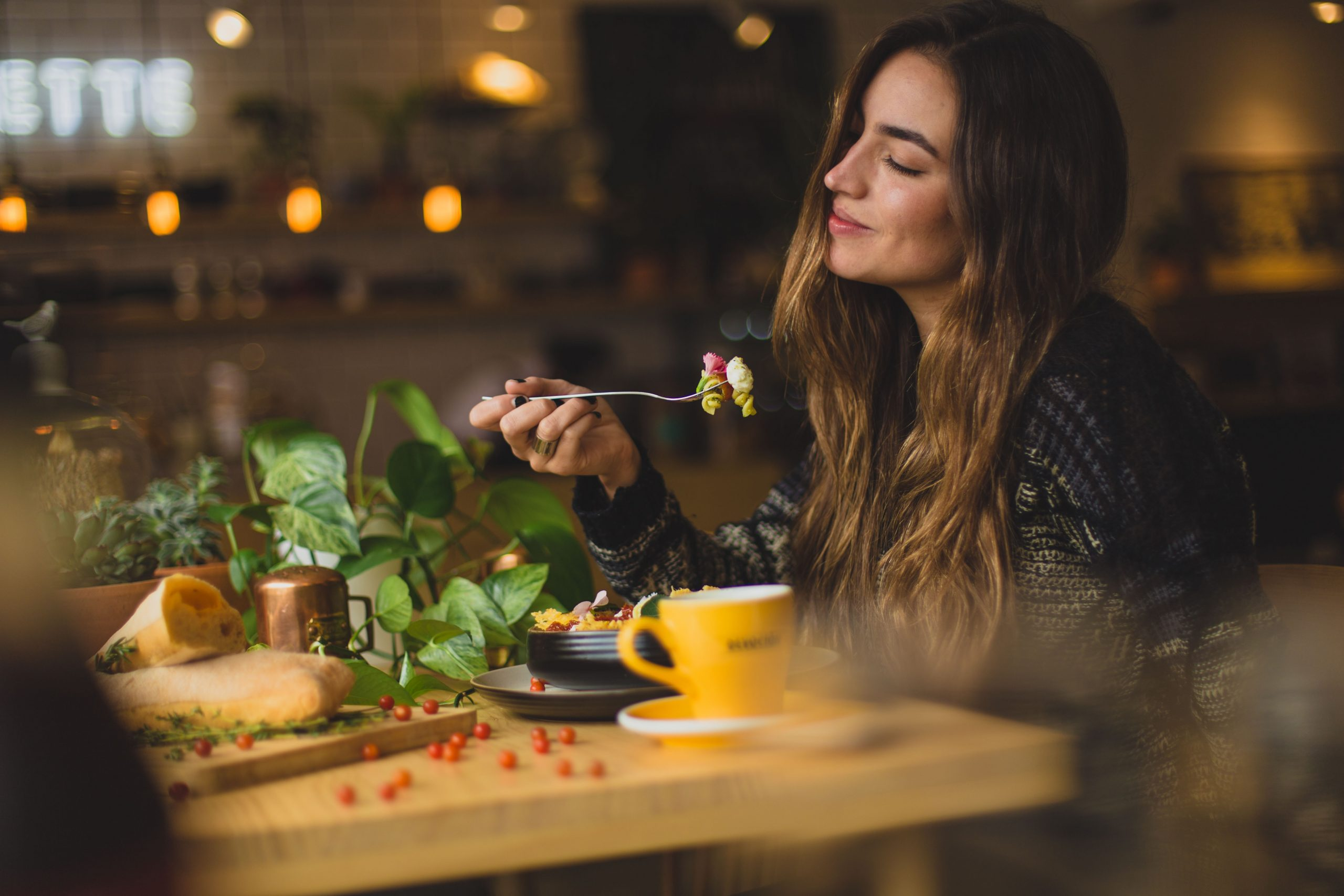 Woman enjoing dinner